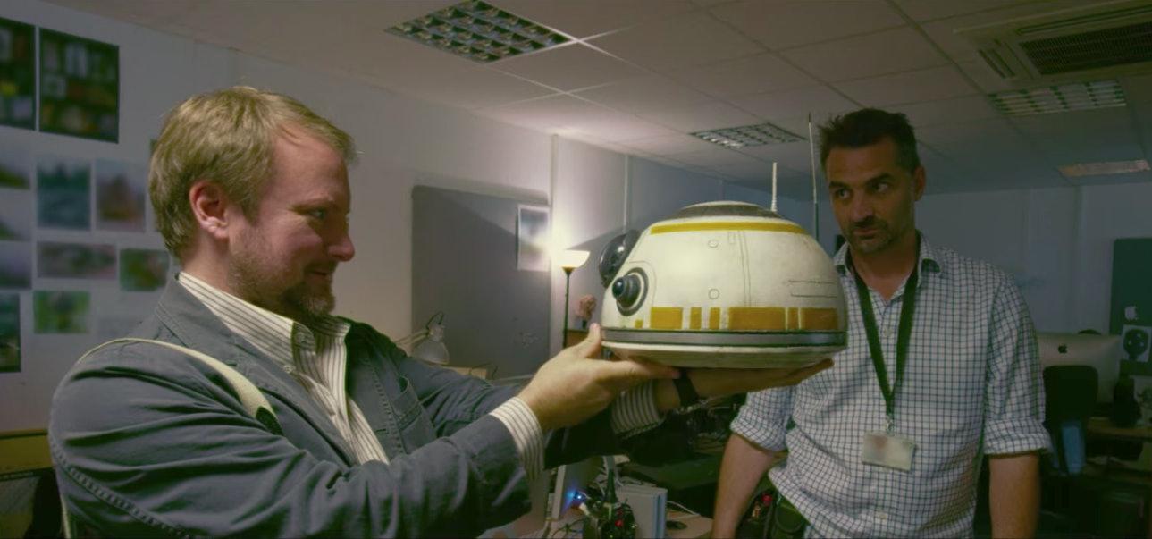 Director Rian Johnson inspects BB-8's head.
