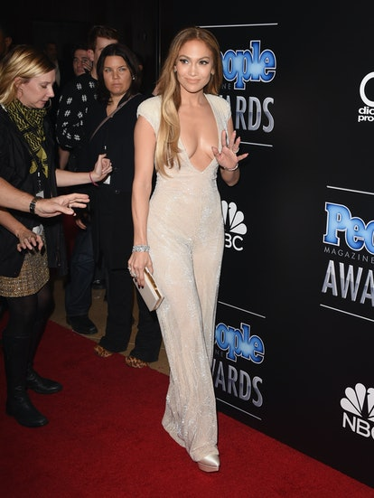These Jennifer Lopez outfits are truly unforgettable, from her Versace dress to her Sean John crop top.