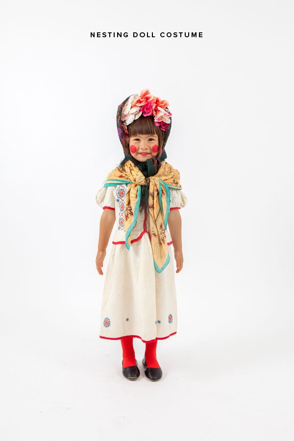 9 diy halloween costume ideas for cheap theyre all 10 or less do you have a couple of bucks to spare to buy dollar store flowers thats all youll need to pull off this adorable nesting doll diy costume solutioingenieria Image collections