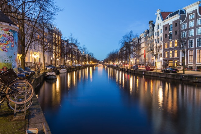 One of the many canals at twilight in Amsterdam