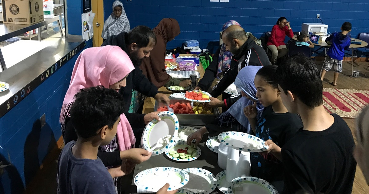 At a small Muslim school, Floridians take shelter, share meals and prepare to ride out the storm