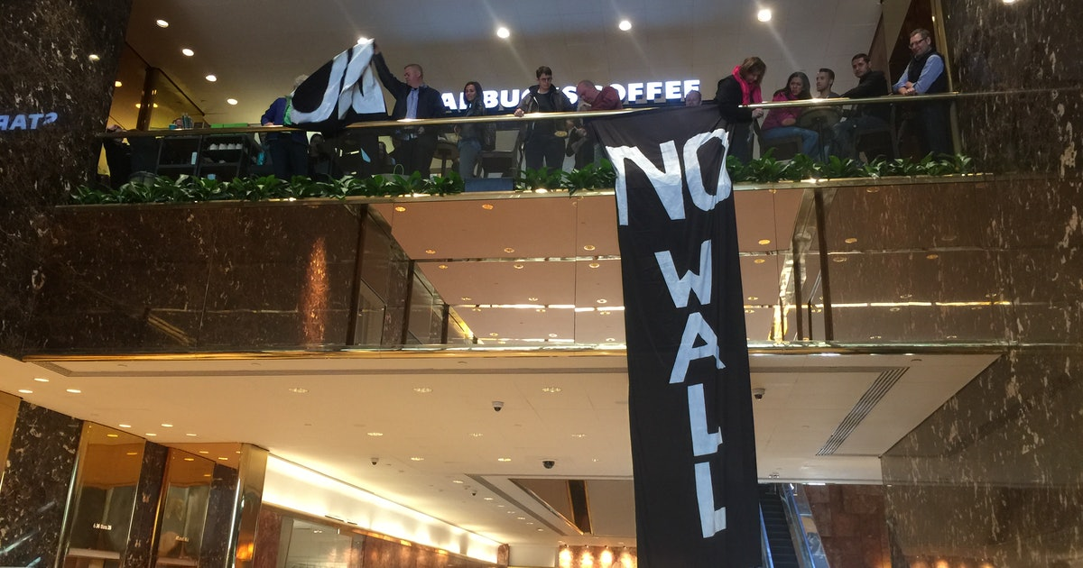 Protesters shut down Trump Tower, dropping banners and blocking elevators