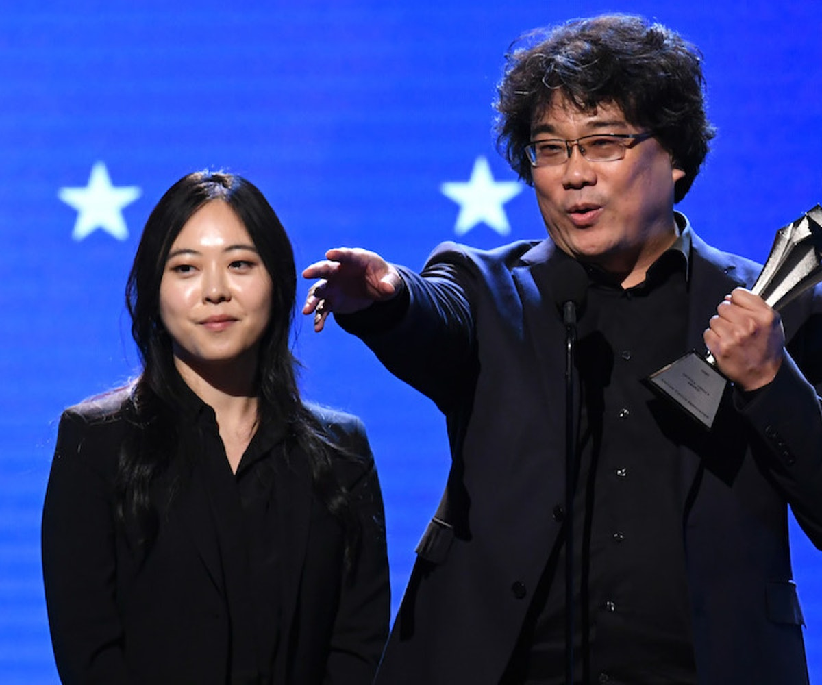 Interpreter Sharon Choi (L) and director Bong Joon-ho accept the Best Director award for 'Parasite' onstage during the 25th Annual Critics' Choice Awards at Barker Hangar on January 12, 2020 in Santa Monica, California.