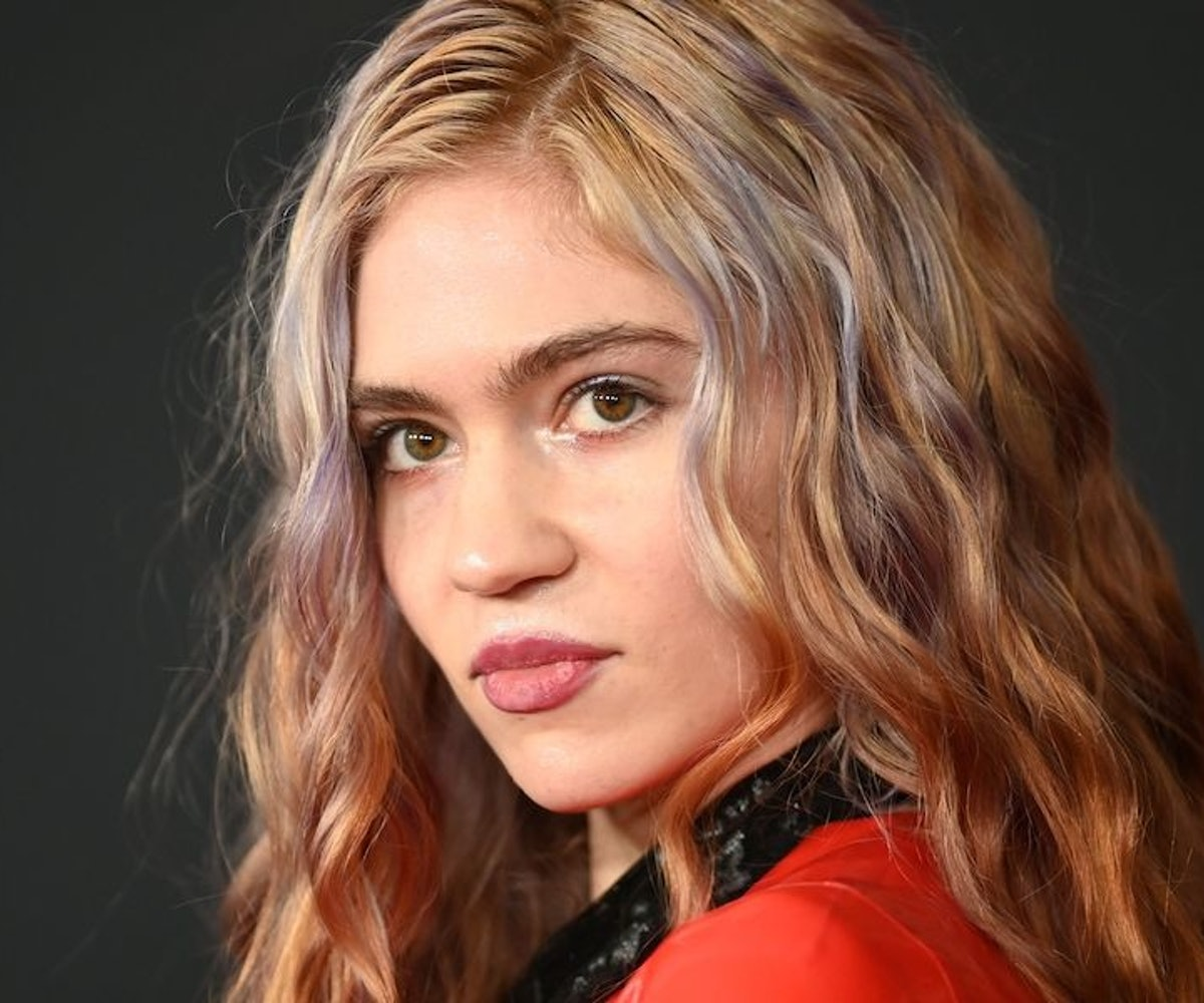 """Canadian singer-songwriter Grimes (Claire Elise Boucher) attends the world premiere of """"Captain Marvel"""" in Hollywood, California, on March 4, 2019."""