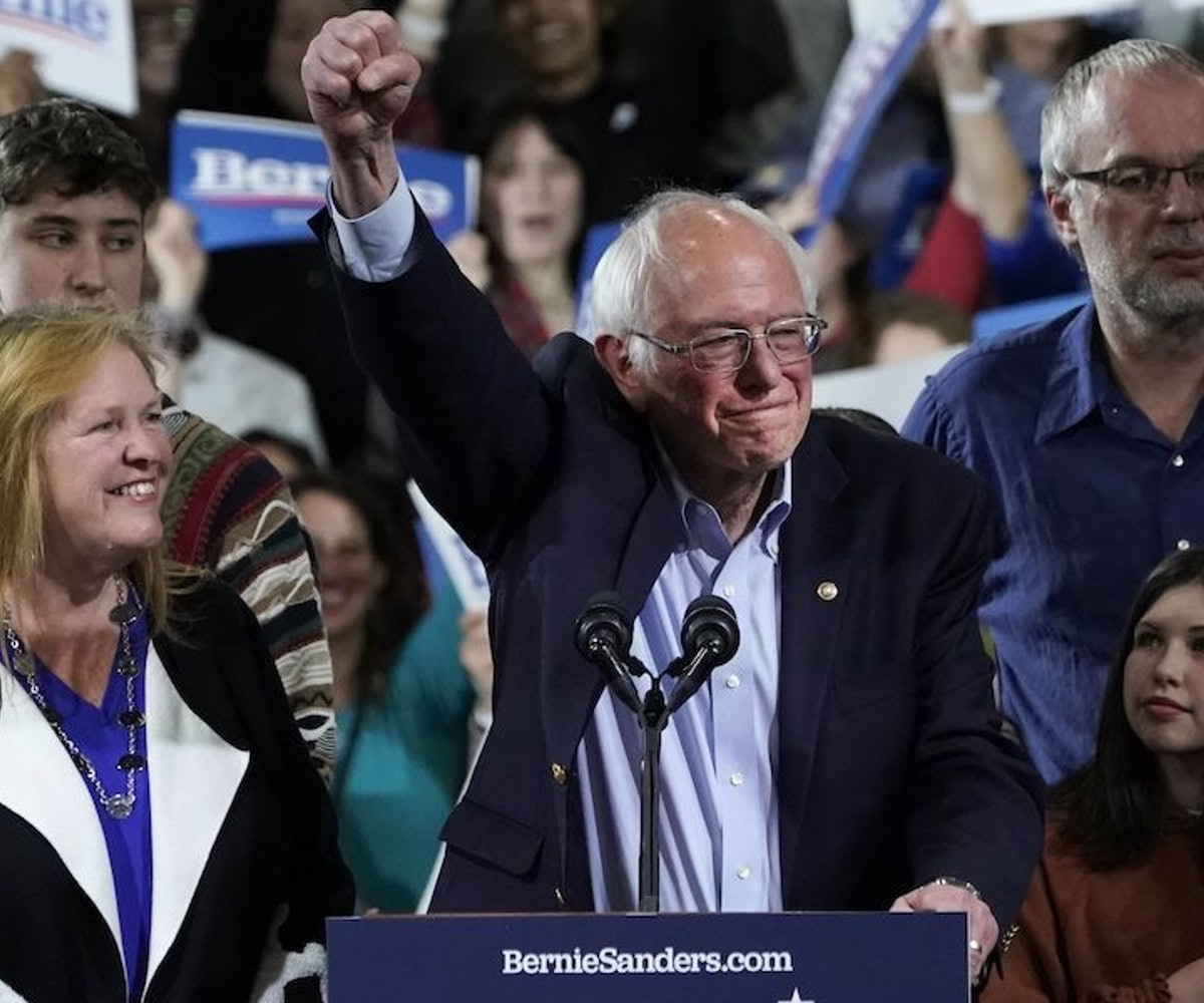 Democratic presidential hopeful Vermont Senator Bernie Sanders accompagnied by his wife Jane O'Meara Sanders (L), his son Levi Sanders (behind) and grandchildren Dylan and Ella, speaks during a 2020 Super Tuesday Rally at the Champlain Valley Expo in Essex Junction, Vermont March 3, 2020