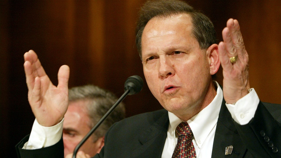 Alabama chief justice suspended over defying same-sex
