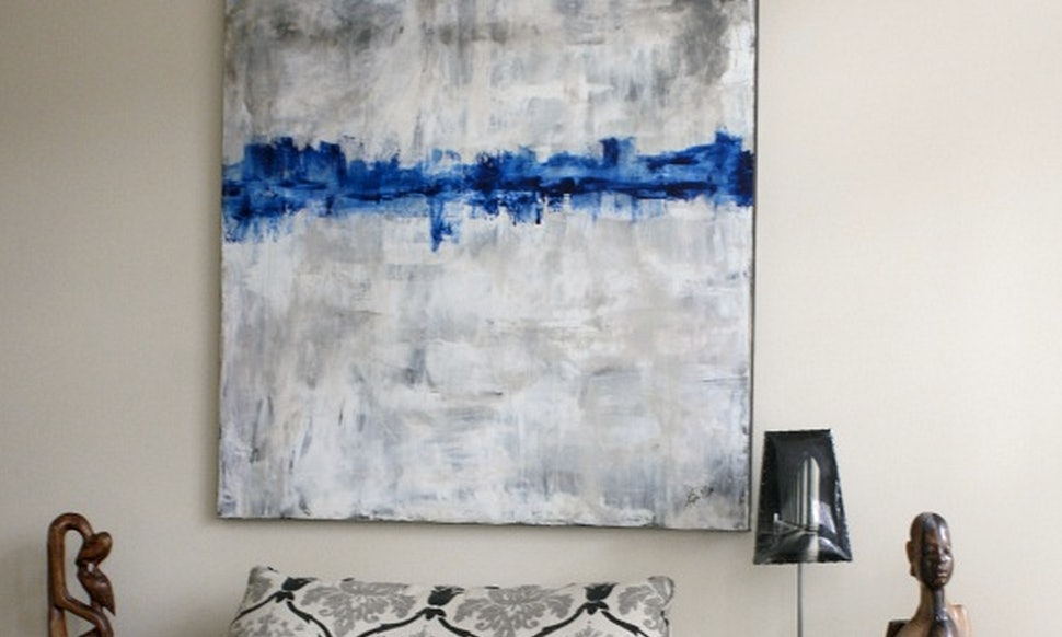 8 Ways To Hang Oversized Art And Instantly Transform Your Living Space