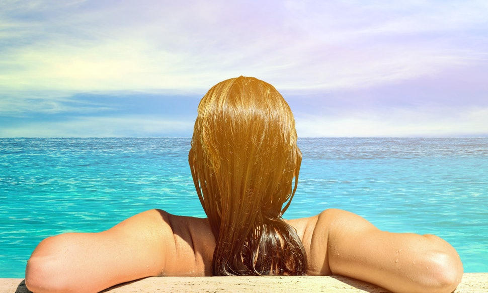 How to prevent your hair from turning green after swimming because it can put a damper on your for How long can you swim after shocking a pool