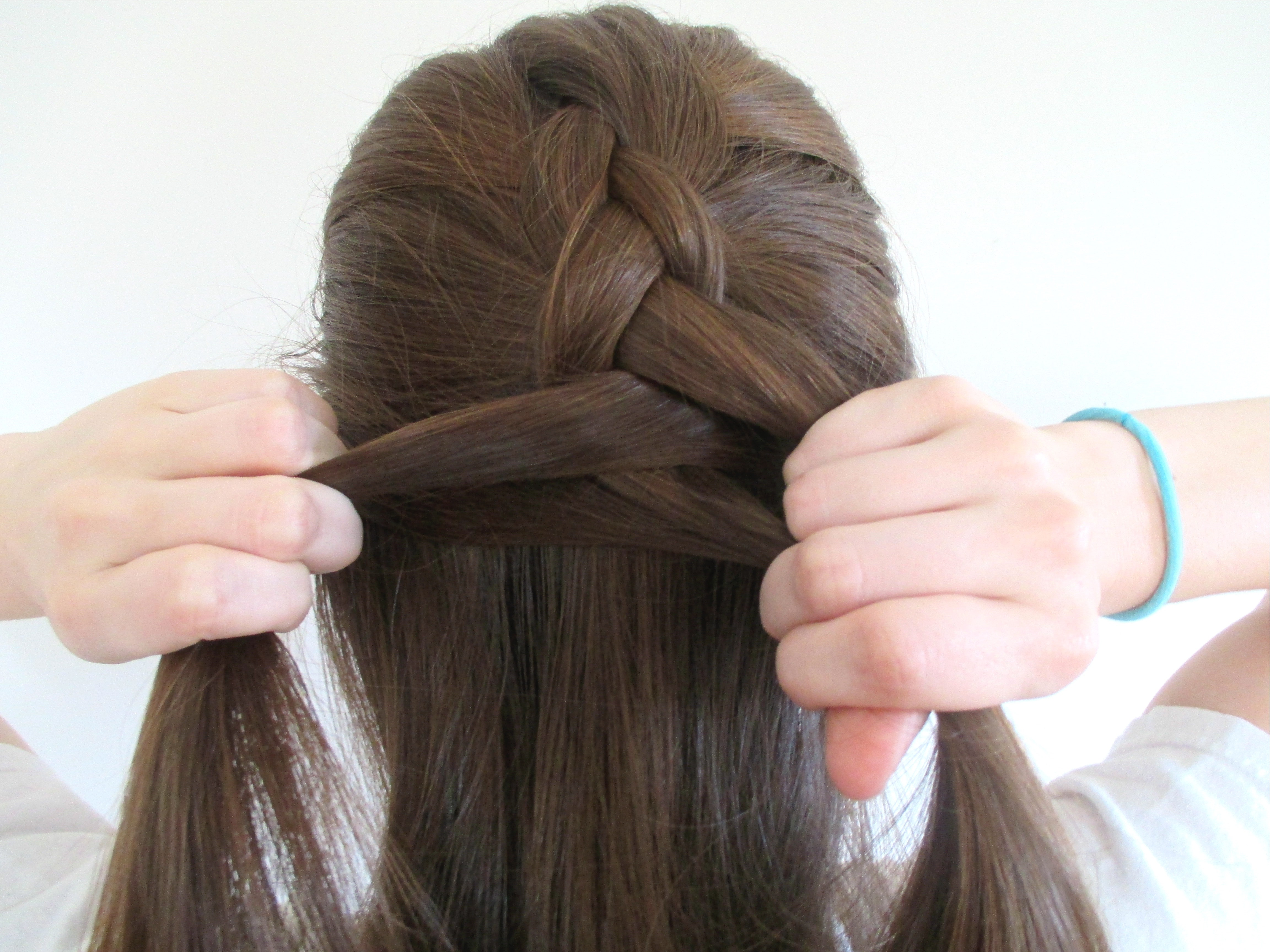 how to reverse french braid in 5 steps then turn it into a faux hawk rh bustle com french braid steps for beginners french braid steps video