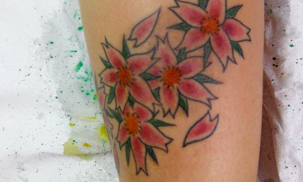 15 pretty flower tattoos that prove floral tattoos arent just about 15 pretty flower tattoos that prove floral tattoos arent just about roses photos mightylinksfo