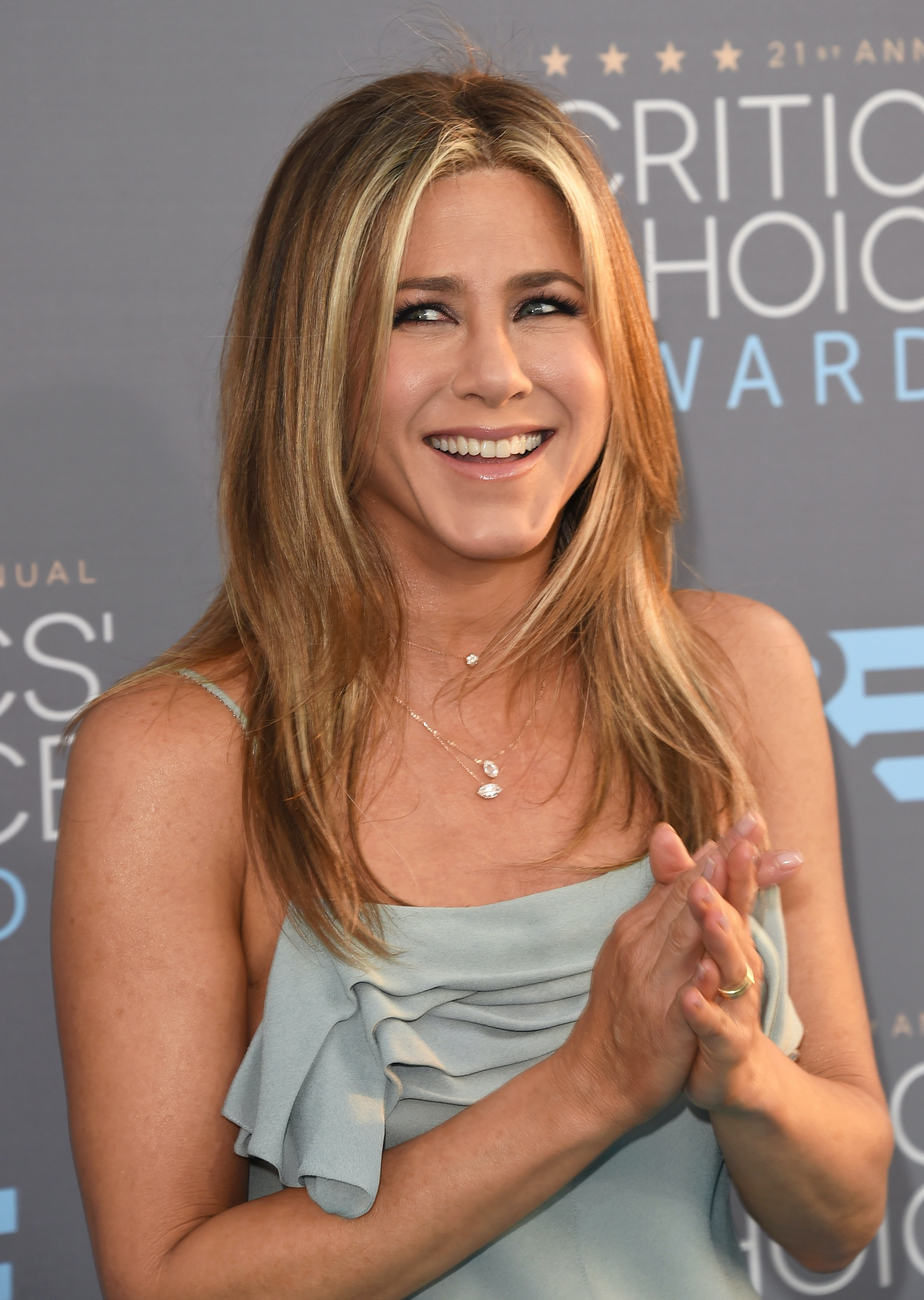 jennifer aniston has a tattoo honoring her dog. what was his name?