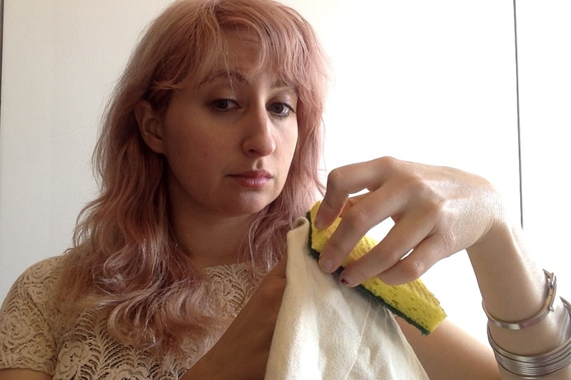 The author takes a sponge to sheets stained with period blood