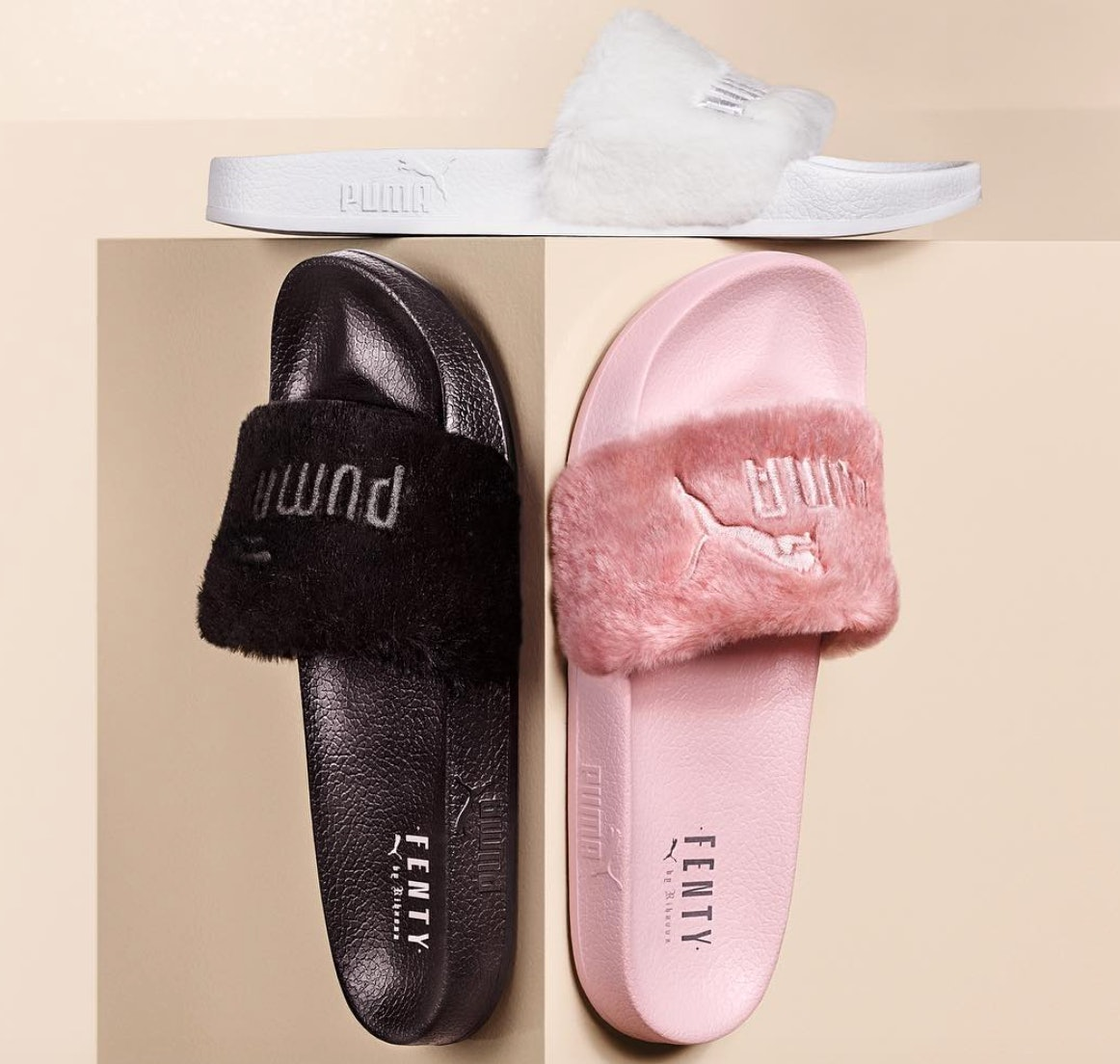 huge selection of 09572 f3959 Are Rihanna's Black, White, & Shell Fur Puma Slides Being ...