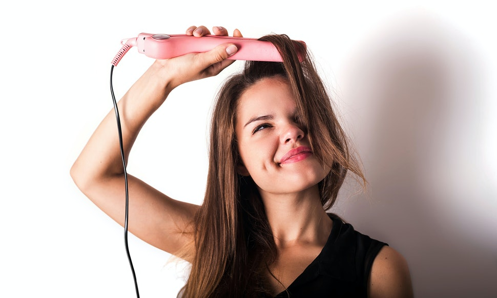 This is a girl straightening her hair.