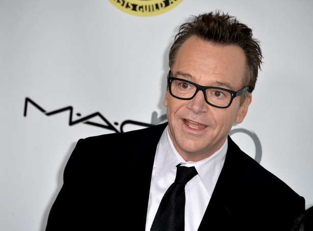 17 celebrities who regret their tattoos from britney for Tom arnold tattoo