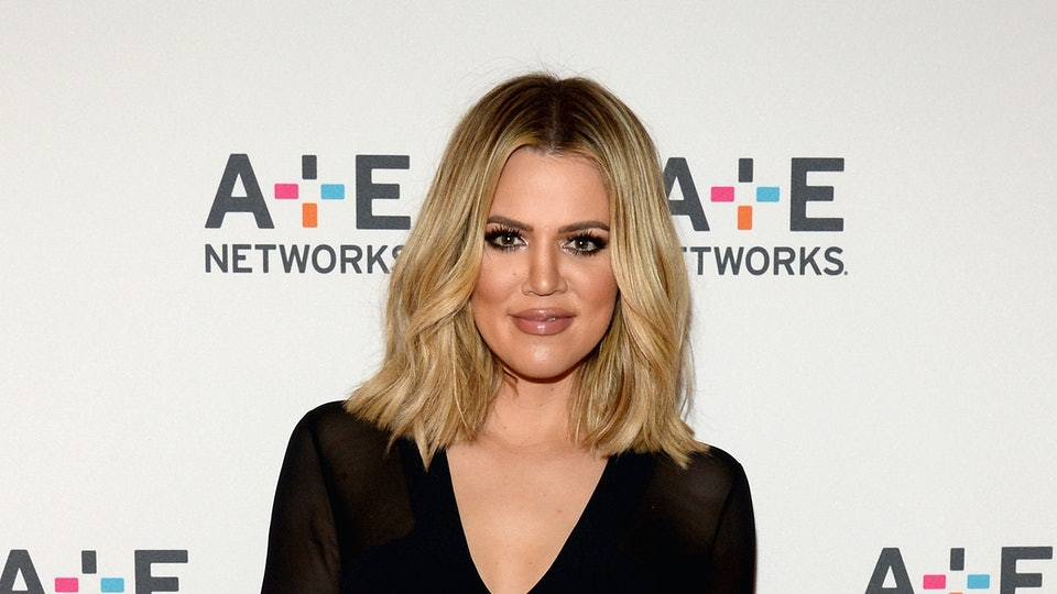Exhausted at seven months pregnant, Khloe Kardashian asked paparazzi to back off.