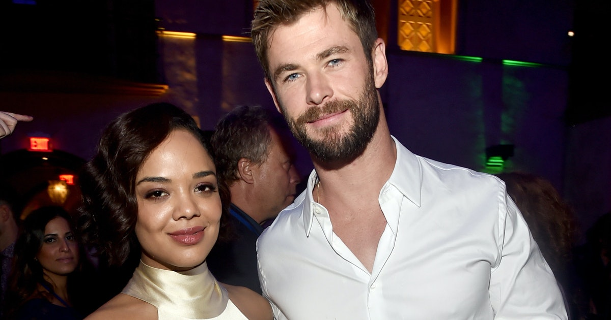The New 'Men In Black' Spin-off Photo Reveals Tessa Thompson & Chris Hemsworth Make Those Suits Look Good