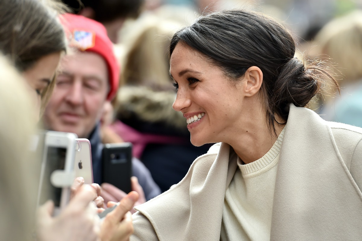Meghan Markle shaking hands when she was a royal. When you want to feel like the former duchess, these princess captions can help.