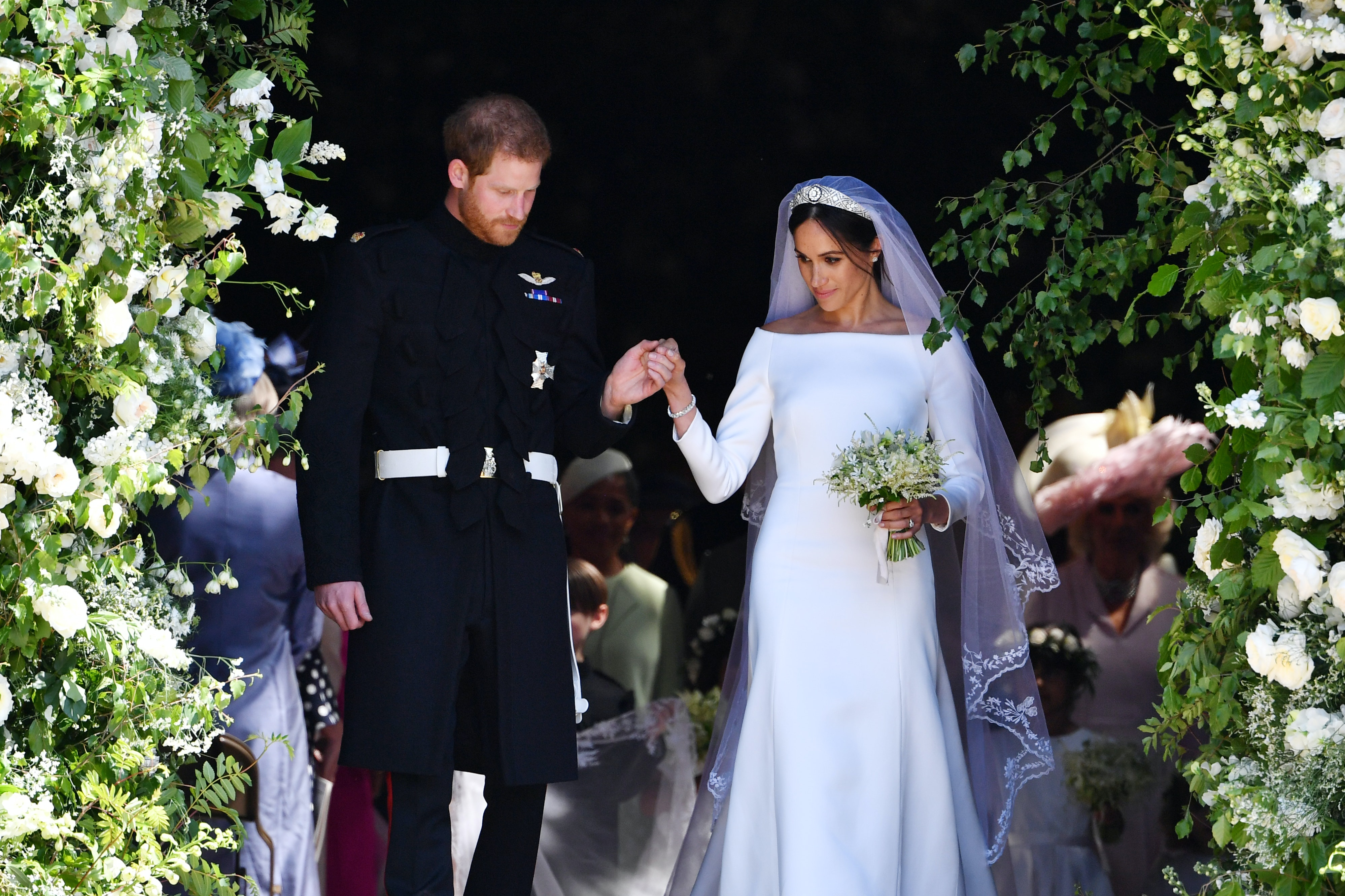 what does meghan markle s second wedding dress look like it s very reflective of her sleek classic style https www bustle com p what does meghan markles second wedding dress look like its very reflective of her sleek classic style 9137740