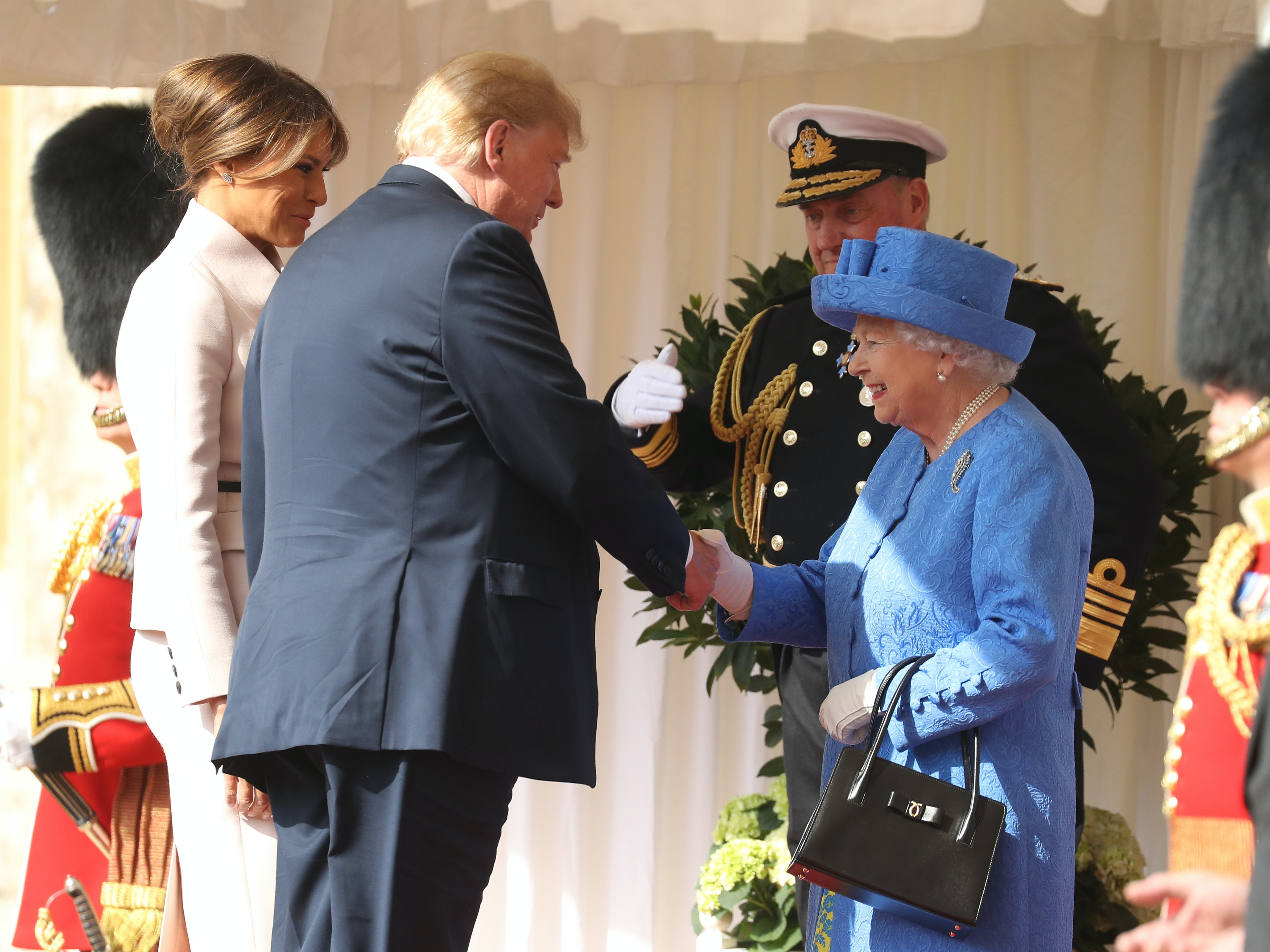 Photos Of Queen Elizabeth With The Trumps Vs Obamas Show How The