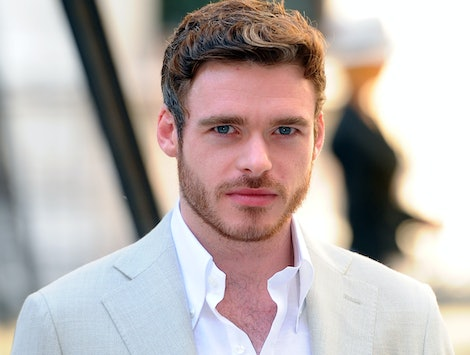 Richard Madden staring into the camera.