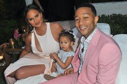 Chrissy Teigen poses with her daughter Luna and husband John Legend.