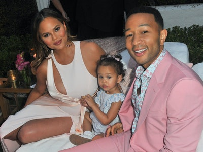 Chrissy Teigen poses with her daughter Luna and husband John Legend.
