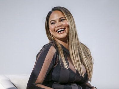 Chrissy Teigen speaks at an event.