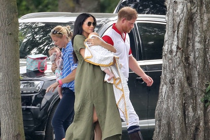 Meghan Markle & Prince Harry with baby Archie at a polo match in July