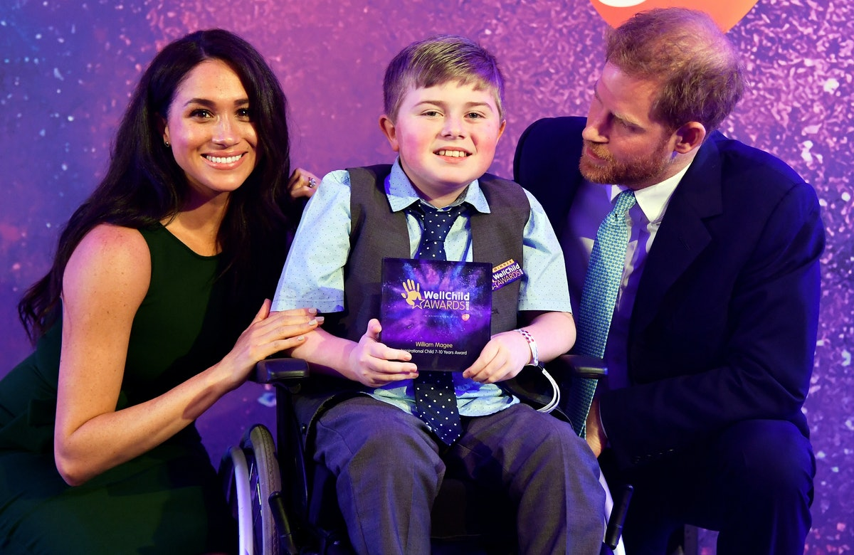 Meghan Markle & Prince Harry pose with child at the 2019 WellChild Awards