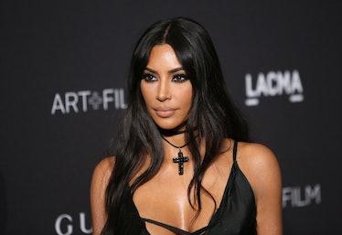 Kim Kardashian stuns in a black slip dress at the LACMA film gala.