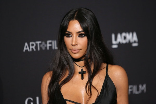 Kim Kardashian stuns in a black slip dress at the LACMA film gala.