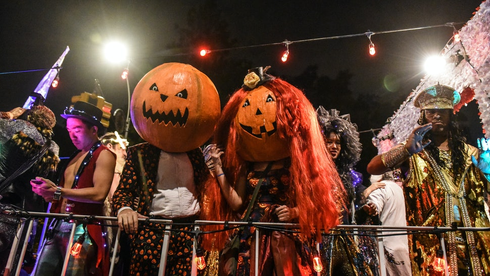 Halloween revelers at a Halloween parade, in full costume. For people who are sober on Halloween, there are plenty of sober ways to celebrate.