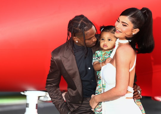 """Kylie Jenner, pictured here with rapper Travis Scott and their daughter, has said Stormi is """"super into makeup"""" and already wants to wear some."""