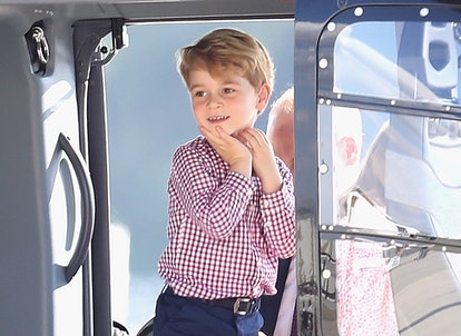 Prince George plays in a helicopter.