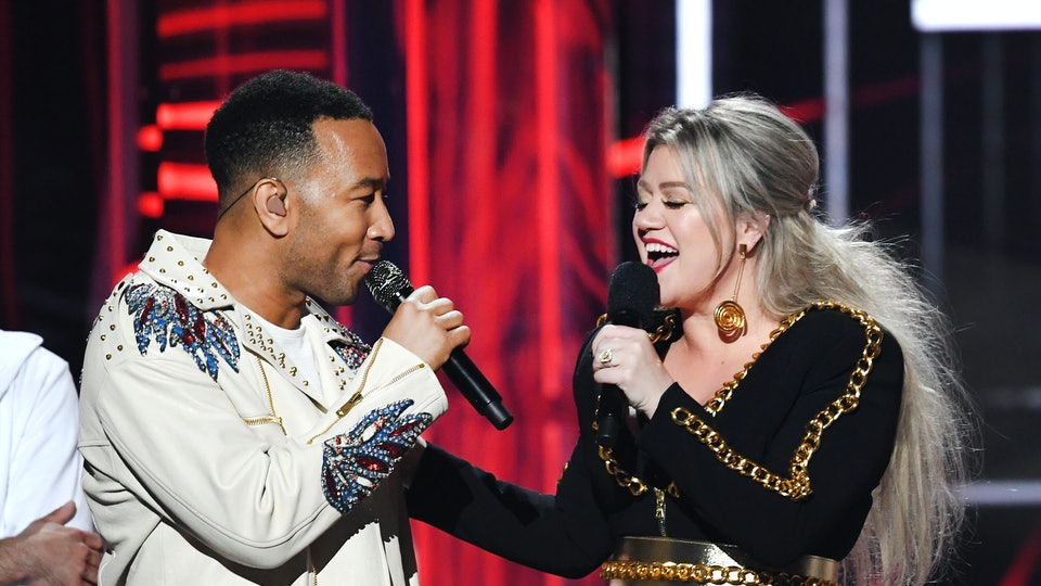 """Kelly Clarkson and John Legend's version of """"Baby, It's Cold Outside"""" will include updated lyrics written by Legend and Natasha Rothwell."""