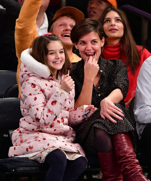 Katie Holmes & Suri Cruise at a basketball game.