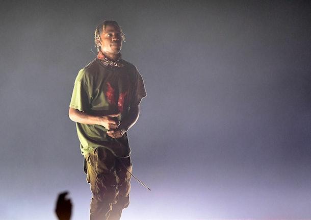 Travis Scott raps on stage