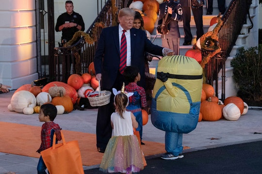 President Donald Trump put Halloween candy on a trick-or-treater's head and the moment has gone vir...