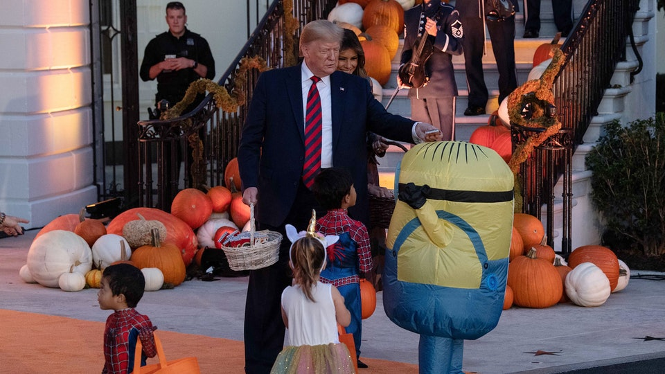 President Donald Trump put Halloween candy on a trick-or-treater's head and the moment has gone viral.