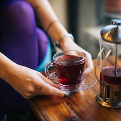 Woman drinking black tea. Tea is one of the healthy drinks that's not water.