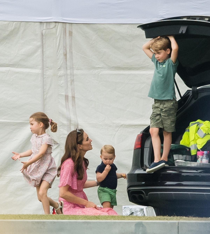 Kate Middleton, Prince Louis, Prince George and Princess Charlotte play outside.