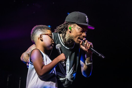 In a recent interview with Kelly Clarkson rapper Wiz Khalifa, pictured here with son Sebastian, shared why coaching his son's baseball team was so important to him.