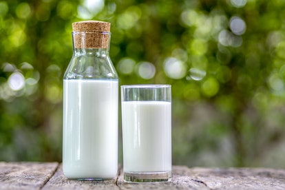 A glass of milk in a carafe and a glass. Milk is one of the healthiest beverages that's not water.