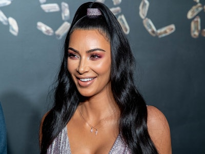 Kim Kardashian, mother of North, Saint, Chicago, and Psalm, poses for a photo.