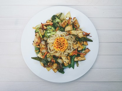 A vegetarian noodle salad is presented on a plate. Flexitarian diets may be beneficial for heart health, according to studies.