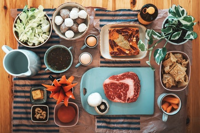 A mix of meats and vegetarian foods on a platter. Eating meat only two days a week will likely substantially change your gut microbiome.
