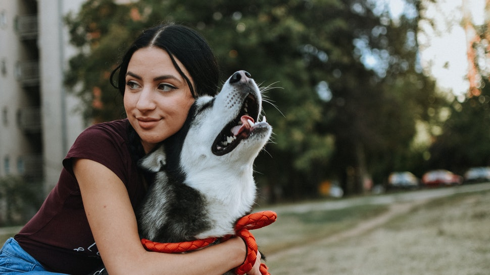A woman looks happy with her dog. Gratitude can improve health outcomes, mental health and our connection with others, according to research.