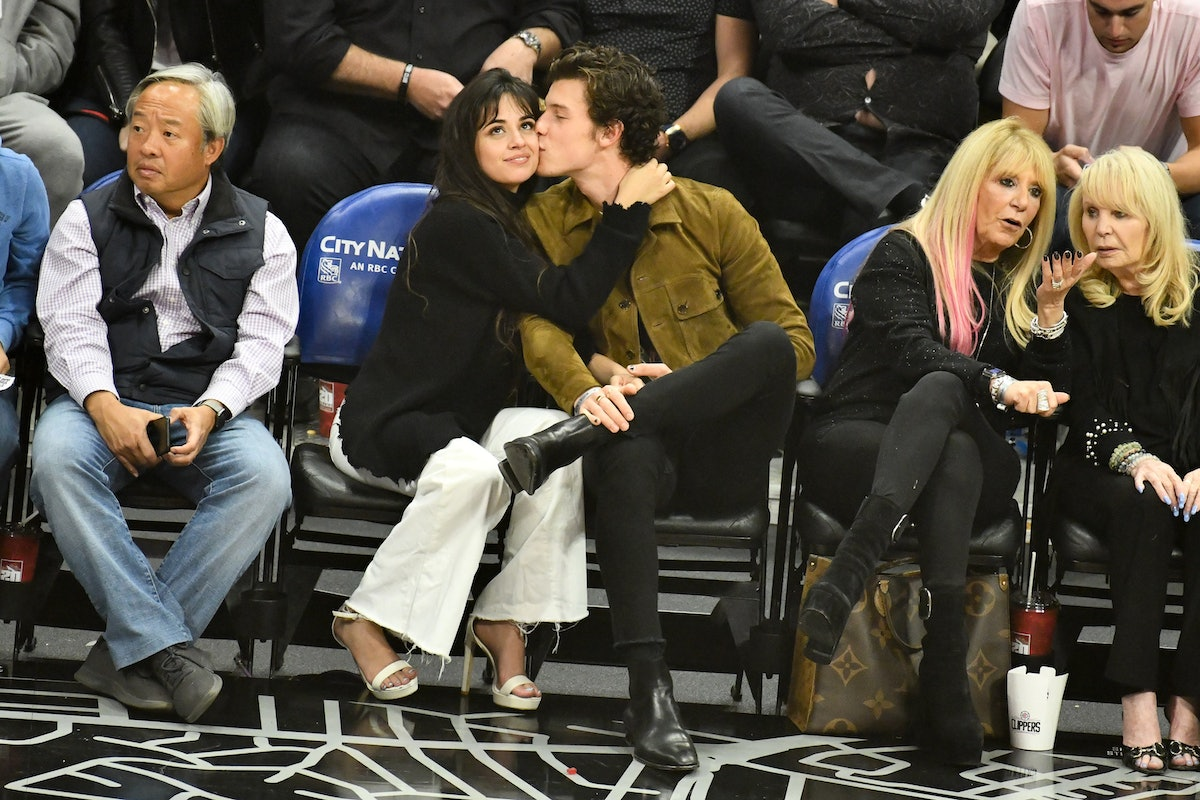 Shawn Mendes kisses Camila Cabello's cheek courtside at a Clippers game on Nov. 11.