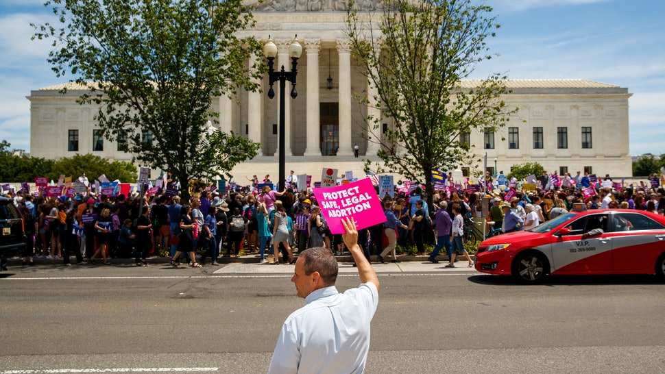 Pro-choice protestors in front of the Supreme Court, which will hear a case with major implications for access across the country.